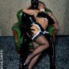 BDSM Aktion mit Hingabe und Zaertlichkeit zwischen Dienstmaedchen und Herr SM Master Andre alias DominusBerlin im Rubber Anzug im Domina Studio Lux Berlin